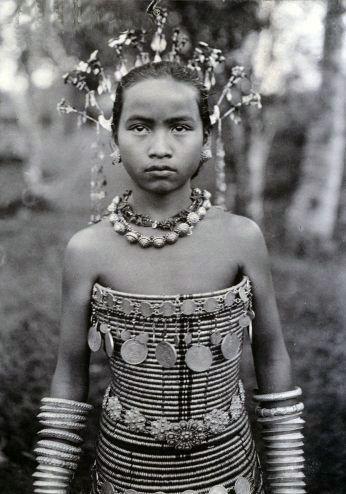 Borneo | Portrait of a Sea Dyaks girl in beaded corset, 1905 | © Robert Shelford / Bridgeman Art Library
