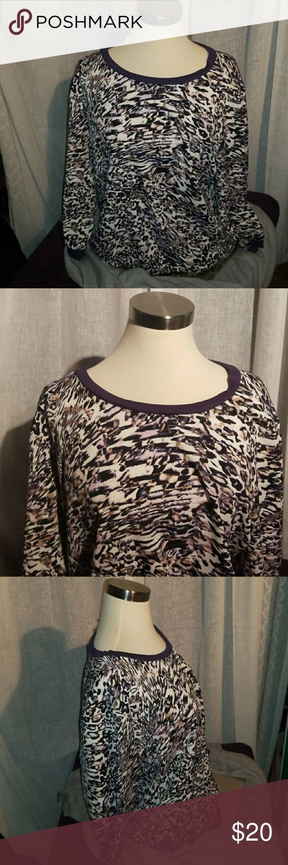 JENNIFER LOPEZ TOP  size large Brand new never worn with out tags. JLO top.        Deep purple stretchy band around wrist and at the bottom.   Polyester shell Jennifer Lopez Tops