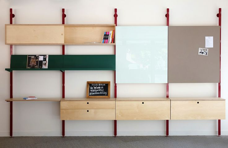 Modular storage unit Featuring magnetic glass wipeboard, Pinboard, Magazine rack and birch ply storage units. Made for the Tridos bank HQ in Bristol, designed with Harmsen Tilney Shane architects and then built in our workshop.