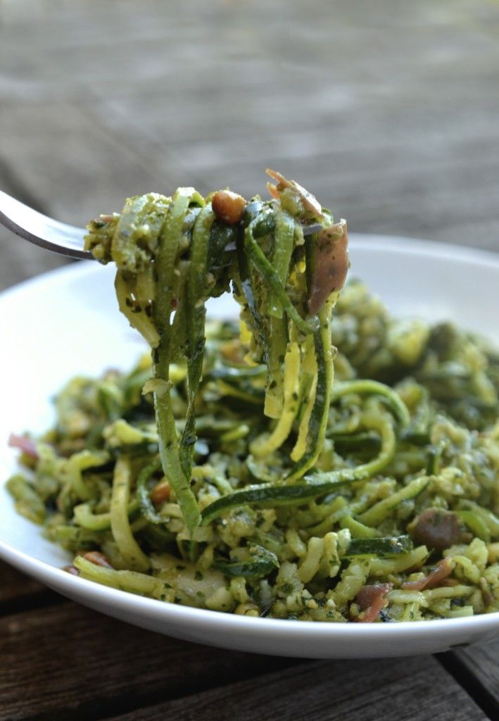 Zucchini Noodles served with a delicious pesto sauce and topped with crisp prosciutto and pine nuts.