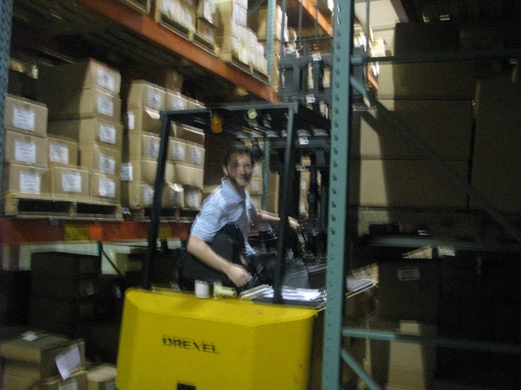 inventory control clerk joey jones moving books at our warehouse - Inventory Control Clerk