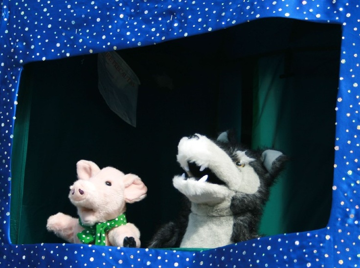 """Is that what I think it is, a flying pizza!  Little Gem Puppets - The Three Little Pigs interactive puppet show. Performed from a punch and Judy style puppet booth, www.littlegempuppets.com."