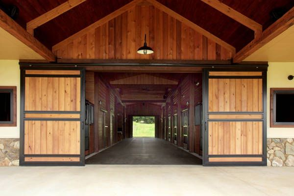 Sliding doors with wood fill by Classic-Equine.