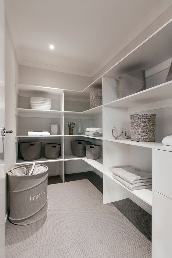 Walk in linen cupboard with room for Vac and drawers for those little extras.