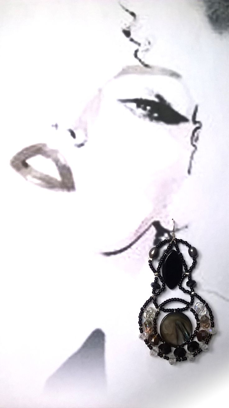 """""""Andromeda"""" Onyx statement earrings from Musesa SS15 Collection. Graphics by David Downtown."""