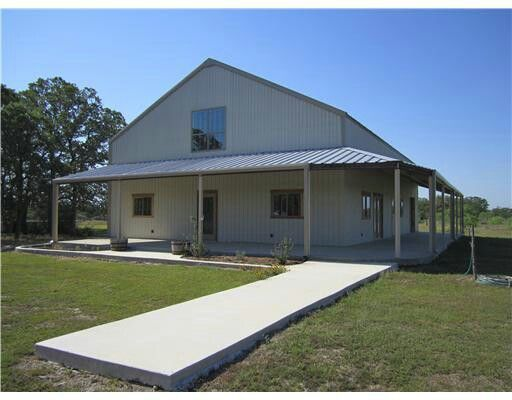 Two story with wrap around porch barndominium for the for 2 story metal buildings with living quarters