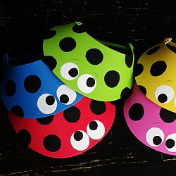 Adorable ladybugs on inexpensive sun visors makes for a fun and simple craft for this kids this summer!