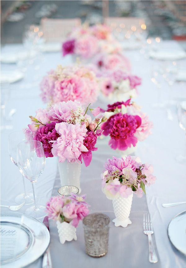 use of white mix glass mixed in- different shapes. Light grey table runner on white table cloth. Light & dark pink flowers
