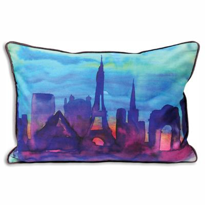 A printed watercolour effect cushion with vibrant sunset tones.
