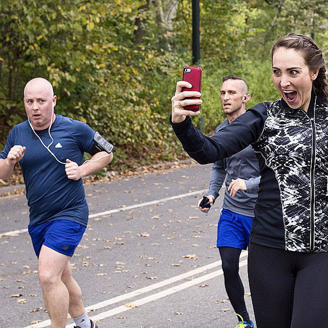 As If Running a Marathon Wasn't Enough, This Girl Took Selfies With 20 Guys Along the Way: Meet Kelly Roberts. She just completed running the New York City Marathon and along the way managed to take over 20 selfies with unsuspecting men to help her find a little extra motivation to make it to the finish line.