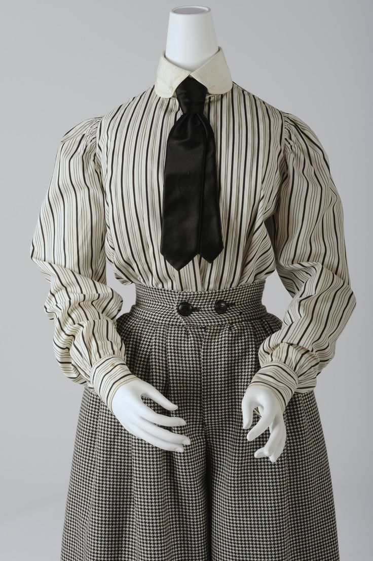 """1900 - Bicycle costume (divided skirt is a replica) - For the first time, women dared to show their legs in public. Not necessarily for sportive reasons, but more a symbolic step towards equal rights. Public reaction was in turmoil and women in trousers were in danger of being attacked. The """"Wiener Mode"""" recommended a simple street costume with a slightly shorter skirt, for bicycle riding."""