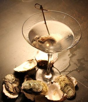 Oyster Martini is delicious and very easy to make mixed drink with vodka,dry white vermouth and smoked oyster.