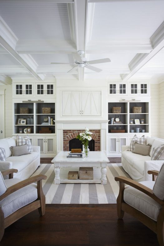 Fresh and clean living room design with beautiful built-ins around the fireplace. Coffered ceiling