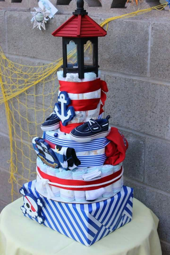 I made this for my daughters baby shower. The cute nautical shapes are a set from Micheals wall hangers. The topper is a wooden bird house and I took the bottom off of it and painted it to look like a lighthouse. The bottom box is a gift box with other baby outfits.