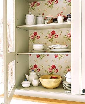 Charming cupboard with vintage-look floral wallpaper