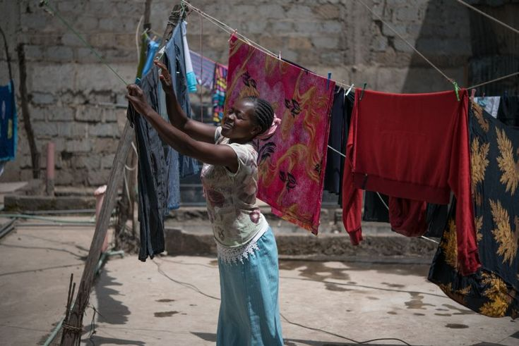 Tabitha Mwikali, 36, a domestic worker hanging clothes for her employer in Eastleigh, Nairobi, Kenya.