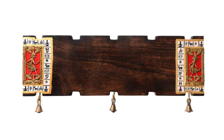 This name plate in mango wood is handcrafted with dhokra figurine & miniature warli hand painting at the border. Bells at the bottom accord an ethnic feel. When put on entrance, it adds a WOW factor to the entry into your residence. Text is handwritten. On receiving your order, we will contact you to take down the name which you desire to get painted.