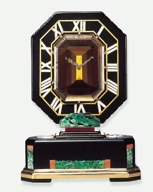 "A HIGHLY IMPORTANT ART DECO JADE, CITRINE, CORAL AND ENAMEL ""MYSTERY"" CLOCK, BY CARTIER, circa 1927.   Signed Cartier, Paris"