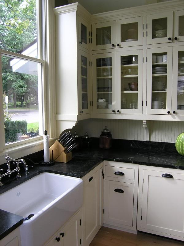 White cabinets, black countertop, drawer pulls; this is our look!  #countertop