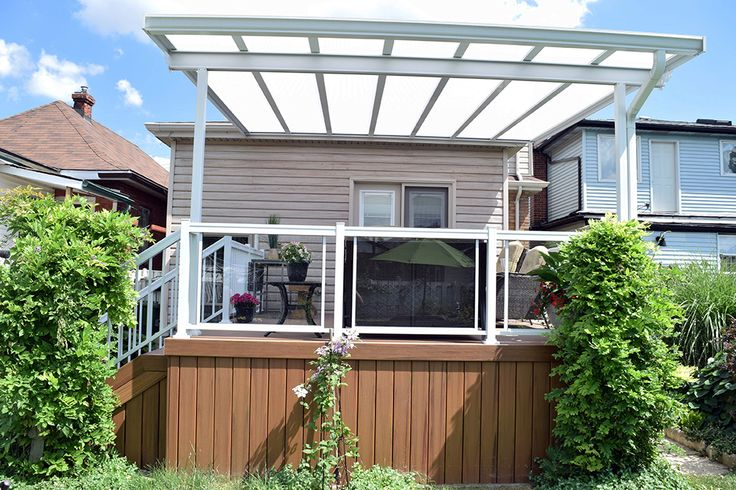This low maintenance deck has a glass roof for shade and water protection.