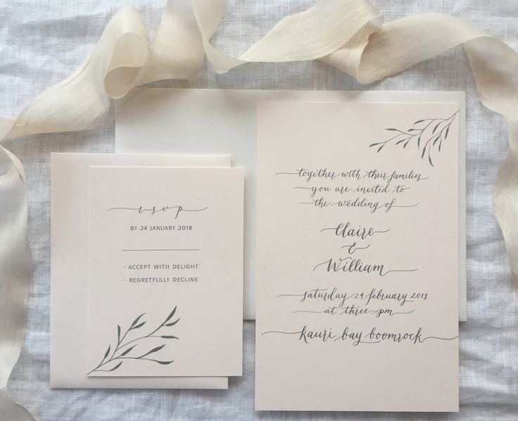 Beautiful soft grey calligraphy wedding invitation suite on a pale pink/rose quartz card with a delicate leaf motif.