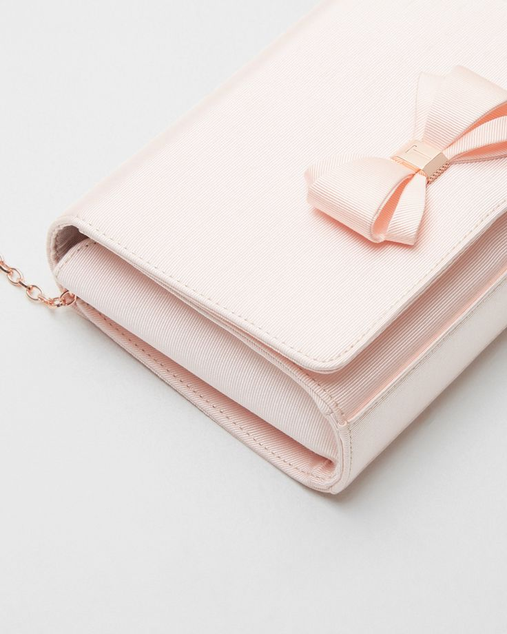 WEDDING ACCESSORIES: pretty pastels and bow detailing make Ted's GRACIEE clutch the perfect complement to your wedding day look. #WedWithTed
