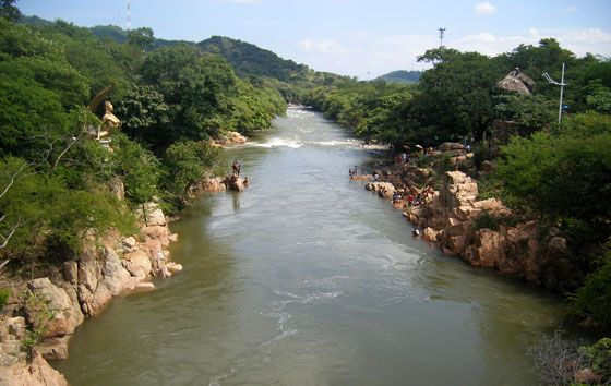 Hurtado River with the gold mermaid on the left riverbank, Valledupar, Colombia