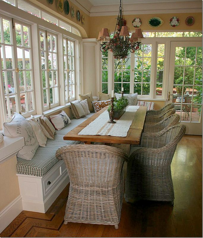 Bench seating in front of kitchen windows use different