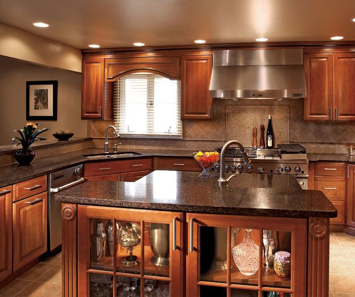 This beautiful dream kitchen has elegant traditional beveled cabinets with rich wood color. These cabinets offer elegance and excellent organization. #DiamondRoomMakeover