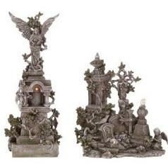 Haunted graveyard with angels on tombstones. Create a spooky Halloween atmosphere with Haunted Cemetery figurines! Shop Halloween decorations now!