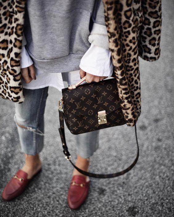 gucci loafers, ripped jeans, louis vuitton pochette metis and leopard coat.