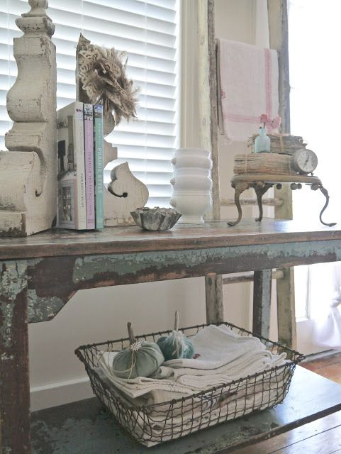 Distressed library table with architectural accessories and French stand at Chateau Chic: Vintage French Cottage Fall Tour