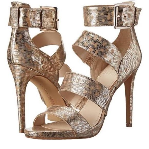 """New Vince Camuto Gold Metallic strappy heels  New in Box...Metallic is hot this season! And strappy heels are hot. So these shoes are double hot! Vince Camuto quality. 4"""" heel. Ankle buckle strap. Vince Camuto Shoes Heels"""
