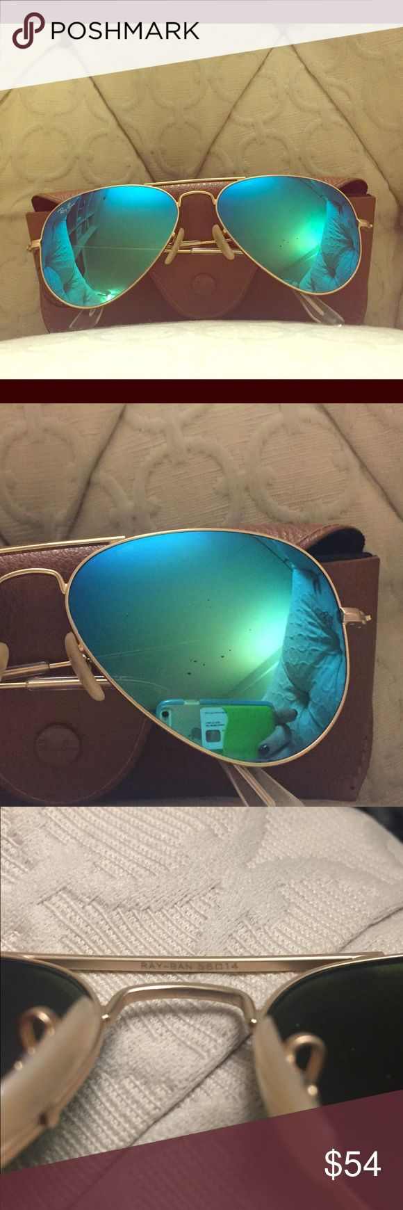 Authentic Ray-Ban Aviator blue flash sunglasses Authentic ray ban aviators in blue flash. Few scratch specks on front lense (pictured). Barely noticeable! Ray-Ban Accessories Sunglasses