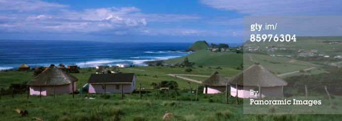 hatched roofed Rondawel huts on a landscape, Hole in the Wall, Coffee Bay, Transkei, Wild Coast, Eastern Cape, South Africa