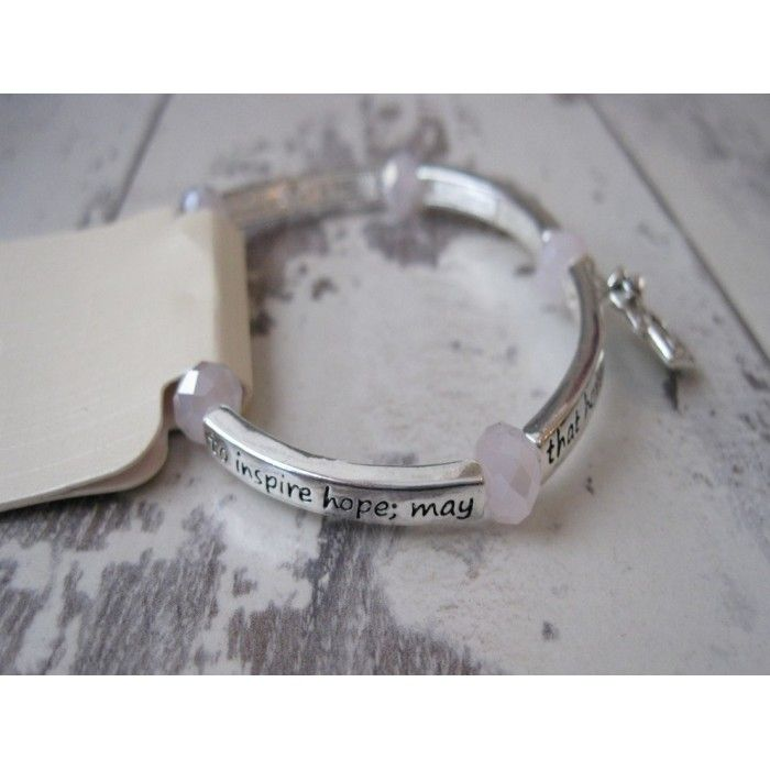 This is a pretty silver Angel bracelet with pink beads. It contains the inscription 'Believe in the power of your inner strength to inspire hope; may that hope ride on the wings of an Angel' www.graangels.ie