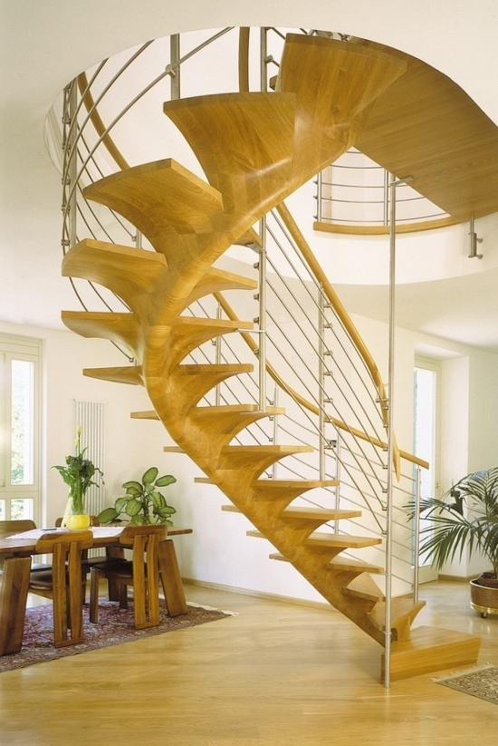 This sleek wood staircase reminds me of an elegant fish making its way up from the depths of the seas.