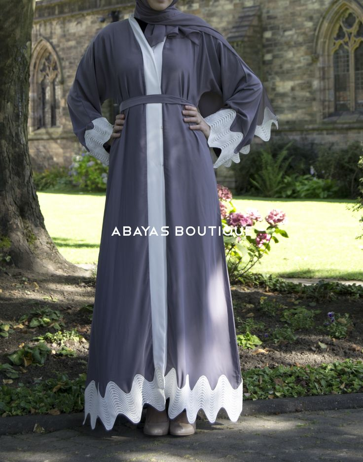 EARL GREY & WHITE LACE OPEN ABAYA  £ 59.99 Earl Grey & White lace Open Abaya is a stylish open abaya made of luxurious fabric and white vintage lace with zig zag design. Elegant design that suit any occassion. Small stud fastening if you wish to wear closed. Matching grey belt is included.