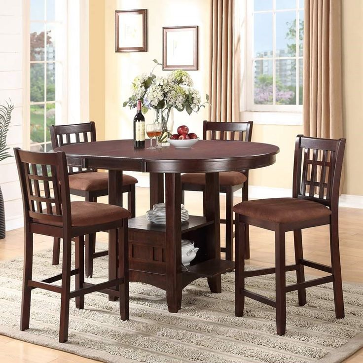 Pull up a counter stool for dinner at this classy dining set made of Asian hardwood in an espresso brown finish. The 4 seats are covered in soft microfiber, and you can add a leaf to the table for extra room. Pence I 5 Piece Counter Height Set | Weekends Only Furniture and Mattress