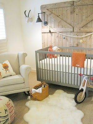 """Also serves as inspiration for my own bedroom.  """"Bold Barn doors used as wall art sets the tone for this nursery. Muted tone colours, wooden toys and the sheep skin on the floor gives this nursery a cozy and rustic feel."""". I love this because it's a reminder of where I've grown up"""