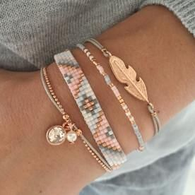 This set includes: Swarovski Pink Beads-bracelet Indian Delicate feather Bracelet