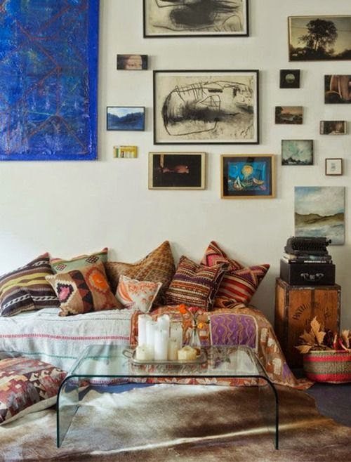 Bohemian Homes: Eclectic Sitting Room.  pillow assortment, picture frame arrangement