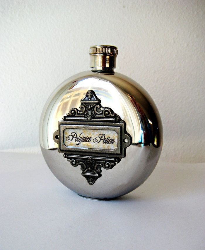 Polished, round, stainless steal Polyjuice Potion hip flask.