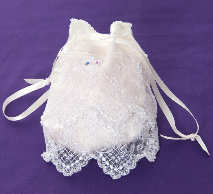 Handmade vintage lace drawstring bridal bag hand embellished with delicate seed beads