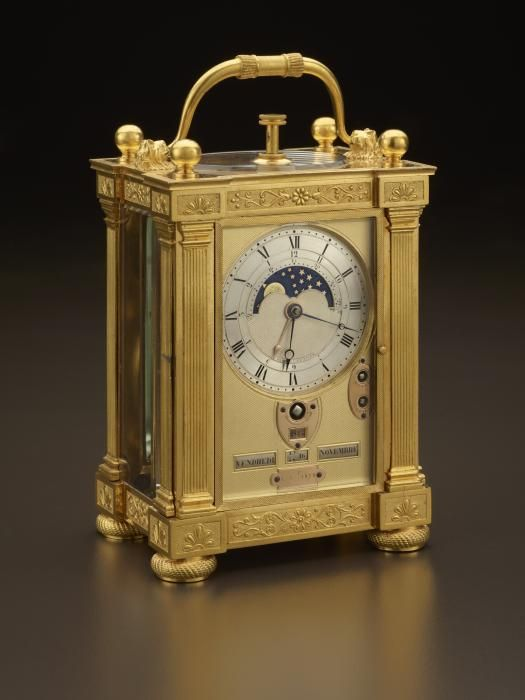 """Gilt-Bronze Carriage Clock with Calendar  Abraham-Louis Breguet (1747–1823) Antoine-Louis Breguet (1776–1858)  Paris, 1811 Dial engraved: """"BREGUET ET FILS NO. 2678""""  Abraham-Louis Breguet designed and made this carriage clock about thirteen years after he invented the first carriage clocks. Such timekeepers were designed to provide all the time-related information the wealthy traveler might need during a long journey:"""