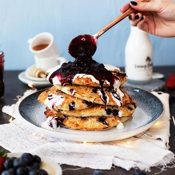 YouFoodz   Blueberry Protein Pancakes $9.95   Fluffy baked protein pancakes laced with sweet blueberry gems, and topped with our blueberry coulis & honey yoghurt   #Youfoodz #HomeDelivery #YoullNeverEatFrozenAgain
