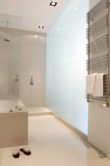:: BATHROOMS :: Ensemble & Associés - Architectes d'Intérieur - Projet Vieille Halle aux Blés. oversized frosted glass wall panel providing a filtering of natural light