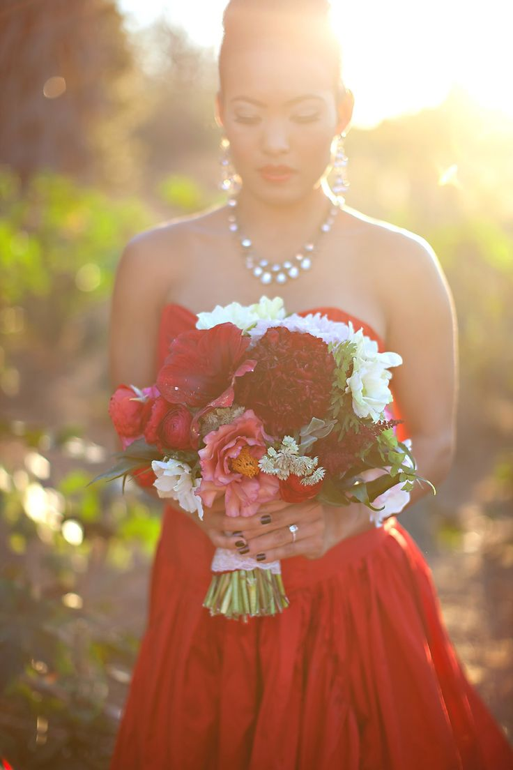 red wedding dress and bridal bouquet