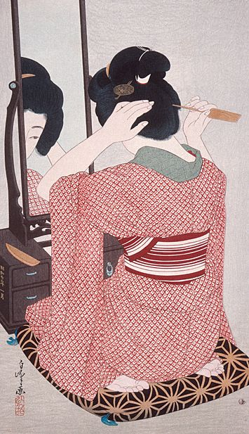 Woman in kimono before a mirror.  Uliyo-e woodblock print, 1932, Japan.  Artist Hirano Hakuho