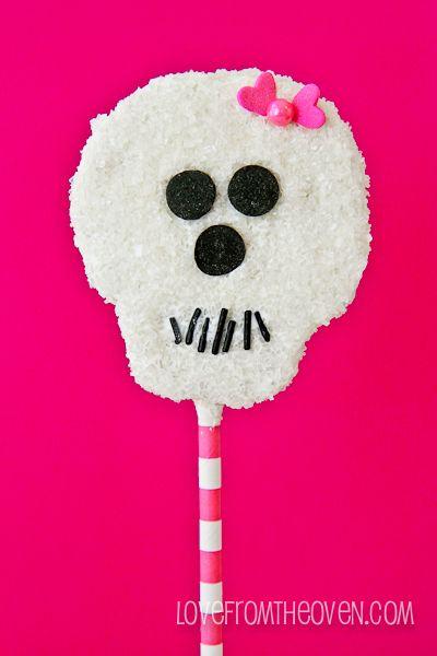 Girly Halloween Skull Pops. Ack, so darn cute! Made from Rice Krispies Treats!